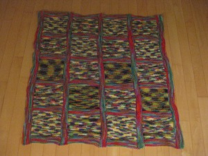 four strips of five blocks with garter stitch borders; main colour plus three secondary colours, altogether