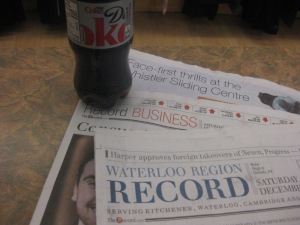 9 a.m. - diet coke and yesterday's paper while the run club people were out running and the store was quiet.