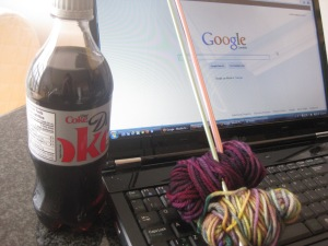 one of my favourite past-times from days of yore: knitting, diet coke and blog reading.