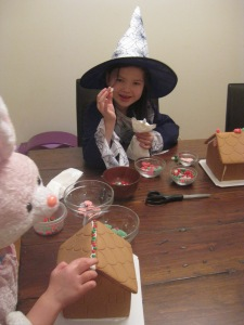 the girls decided to wear their hallowe'en costumes to the g'bread house party! (??!)