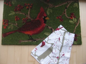 "a cardinal floor mat from paul and sharon; cardinal tea towels from ""santa!"""