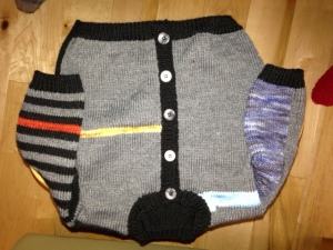 there was so much sock yarn left over that i whipped up a baby cardi...